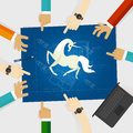 Unicorn start-up tech company hands pointing white horse around the blue print with sketch drawing Royalty Free Stock Photo