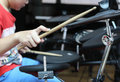 Unidentified Asian boy play electronic drum electronic drum Royalty Free Stock Photo