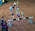 Unidentified boys run 2,000 m. steeplechase race Royalty Free Stock Photo