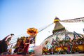 Unidentified buddhist pilgrims near stupa boudhanath during festive solemn puja khatmandu nepal dec of h h drubwang padma norbu Royalty Free Stock Photo