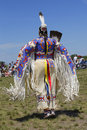 Unidentified female Native American dancer wears traditional Pow Wow dress during the NYC Pow Wow Royalty Free Stock Photo