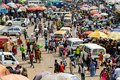Unidentified Ghanaian people buy and sell goods at the Kumasi m Royalty Free Stock Photo