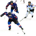 Unidentified hockey players compete Stock Image
