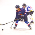 Unidentified hockey players compete Stock Images