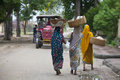 Unidentified Indian womans carries a big bag on her head Royalty Free Stock Photo