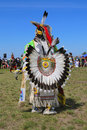 Unidentified male native american dancer wears traditional pow wow dress with dance bustle during the nyc pow wow new york june in Stock Photography