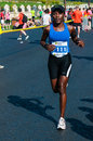 Unidentified marathon runner competes Royalty Free Stock Images
