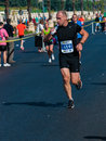 Unidentified marathon runner competes Royalty Free Stock Photography