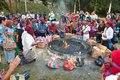 Unidentified Mayan people and tourists surround a fire in Tikal Royalty Free Stock Photo