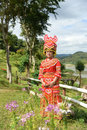 Unidentified Mong tribe young woman with traditional clothes and Royalty Free Stock Photo