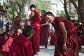 Unidentified monks debate at sera monastery lhasa may on may in lhasa tibet debating is part of the curriculum to become Stock Photography