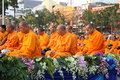 Unidentified monks wait the auspicious to walk to the public alm Royalty Free Stock Photography