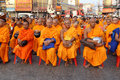 Unidentified monks wait the auspicious to walk to the public alm Stock Image