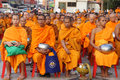 Unidentified monks wait the auspicious to walk to the public alm Stock Photos