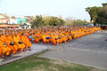 Unidentified monks wait the auspicious to walk to the public alm Stock Images