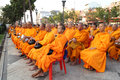 Unidentified monks wait the auspicious to walk to the public alm Royalty Free Stock Photo