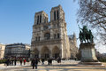 Unidentified people in front of the notre dame cathedral of paris france on march Stock Photo