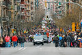 Unidentified people in the middle of Sants Street with carnival parade approaching Royalty Free Stock Photography
