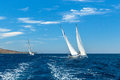 Unidentified sailboats participate in sailing regatta 12th Ellada Autumn 2014 among Greek island group in the Aegean Sea Royalty Free Stock Photo