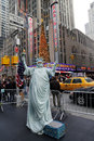 Unidentified street performer poses as a statue of liberty in the front of new york city landmark radio city music hall december Stock Images