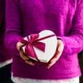 Unidentified woman holding a small gift. Concept of celebration Royalty Free Stock Photo