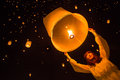 Unidentified woman release khom loi during yi peng festival chiang mai thailand november the sky lanterns or krathong on Stock Image