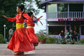 Unidentified women dressed in red dancing in india darjeeling may two on a square during the sunset Stock Photos