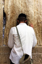 Unidentified young man praying at the wailing wall western wall Stock Image
