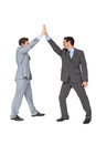 Unified business team high fiving each other on white background Royalty Free Stock Image