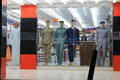 Uniforms showcase of menswear shop with samples of military and service umm al quwain united arab emirates Royalty Free Stock Photography