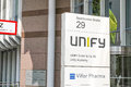 Unify munich sign infront of the offices in copy space to the left Stock Photo