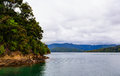 Uninhabitable island in Queen Charlotte Sound bay. New Zealand Royalty Free Stock Photo