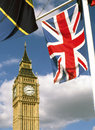 Union flag and big ben in parliament square westminster london with elizabeth tower beyond Royalty Free Stock Photos