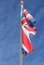 Union flag slight movement in wind against bright blue sky Stock Photo