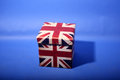 Union jack box on a blue background Stock Images