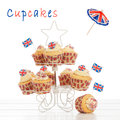 Union jack cupcakes on stand with a white background Royalty Free Stock Photo