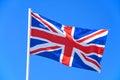 Union jack flag against a blue sky.