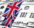 Union jack flag of great britain flying on mast Royalty Free Stock Images