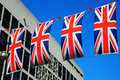 Union jack flags national flag of the united kingdom hung across a london street Royalty Free Stock Images