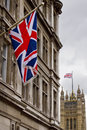 Union Jack with Houses of Parliament in distance Royalty Free Stock Image