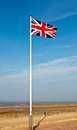 Union jack on normandy beach flag flying over d day france Stock Photography
