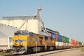 Union Pacific train with freight neary grainery Royalty Free Stock Photos