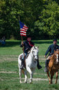 Union soldiers ready to ride on horse back are preparing on horse back during a reenactment from the jackson michigan civil war Stock Image
