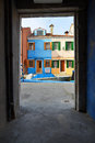 Unique all colored island burano its particular houses framed portico Stock Photos