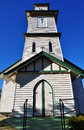 Unique angled photograph small country church quaint rural village town beautiful clear blue sky behind photograph was taken Royalty Free Stock Photo
