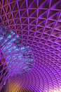 Unique structure at concourse of london king cross railway station in evening with blue purple highlight Stock Images