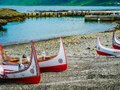 Unique tribe carving boats in ports. A local aboriginal tribe of Lanyu island, Taiwan - Yami / Tao. Royalty Free Stock Photo