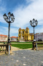 Unirii square in timisoara romania with roman catholic episcopal church background Stock Images