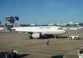 United Airlines passenger jet at terminal Stock Photography