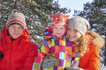 United family mom dad daughter friendly in a snowy forest Stock Photos